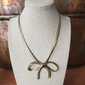 Gorgeous gold bow tied necklace